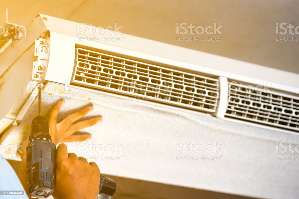 technician open air condition for clean and repair stock photo