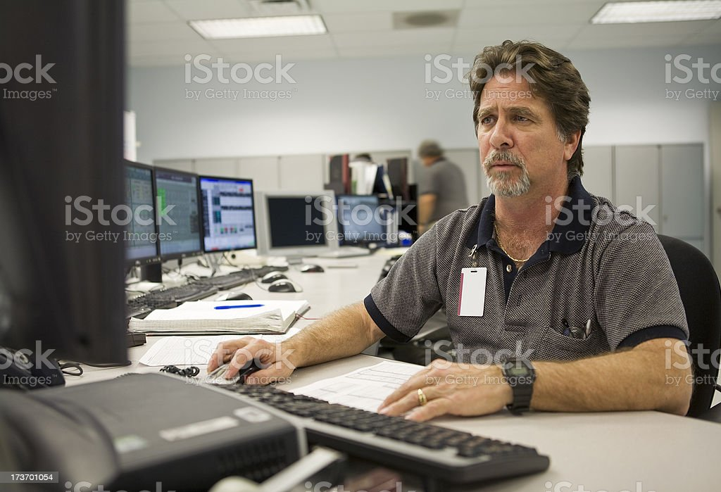 Technician Operates Computer in a Control Center royalty-free stock photo