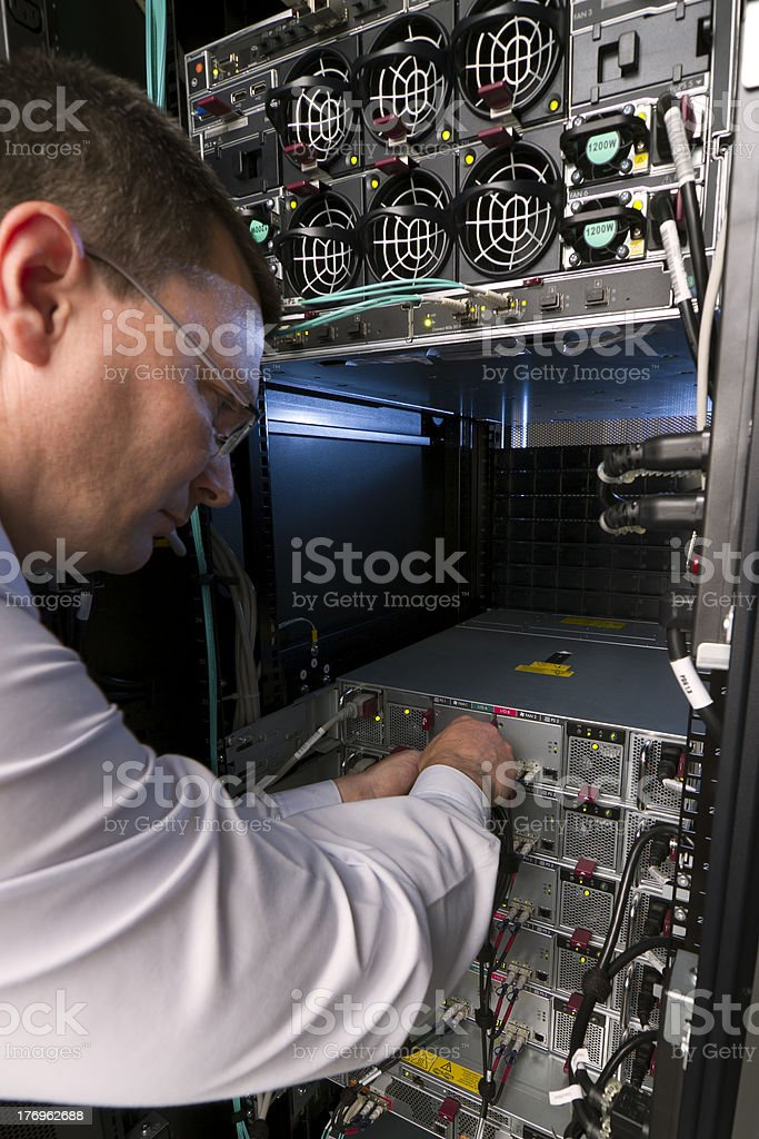 Technician perform preventive maintenance to a server royalty-free stock photo