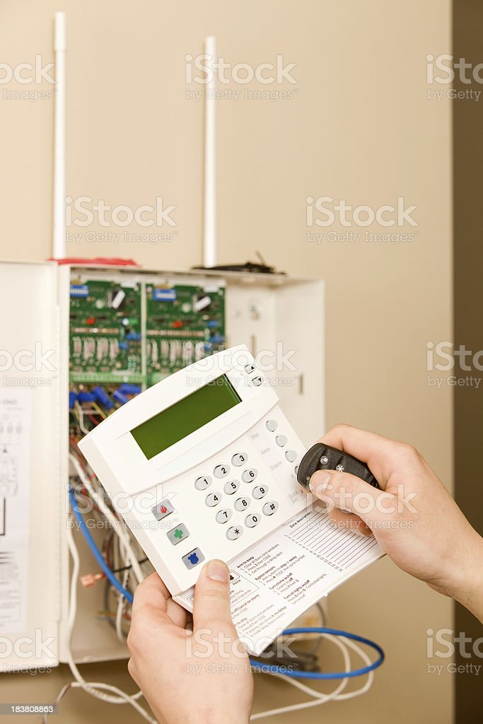 Technician Prepares to Program Home Security system Key Fob stock photo