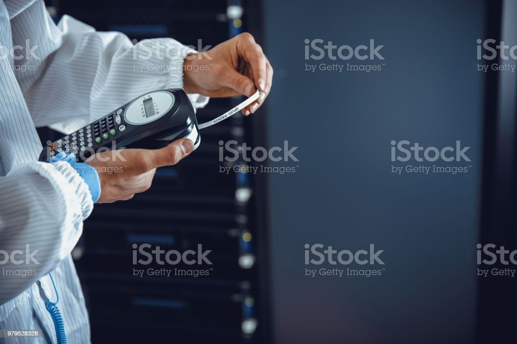 IT Technician Printing Out Sticker for Network Server Labeling.