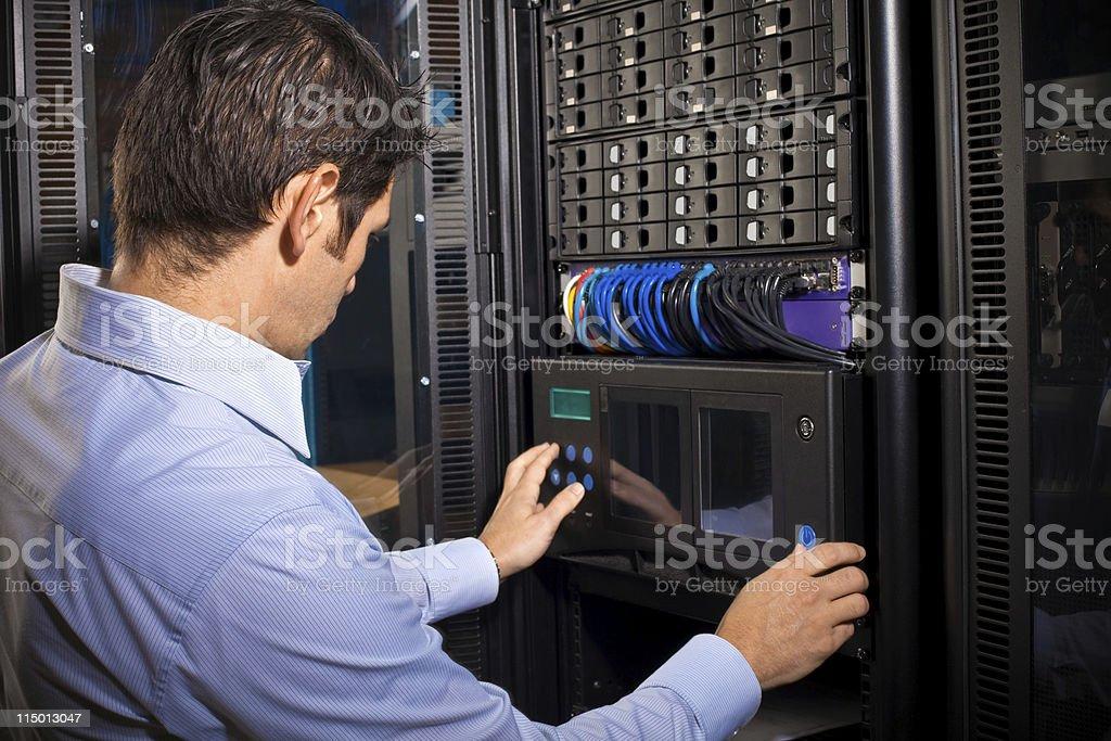 IT Technician Programming Computer Equipment in Server Room royalty-free stock photo