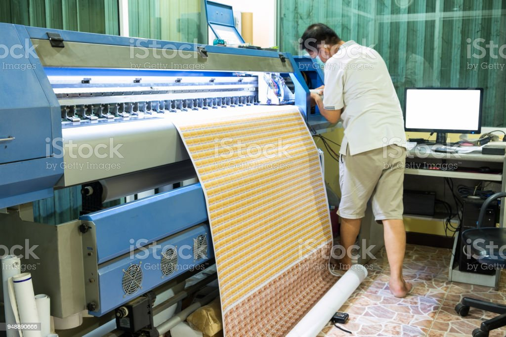 Technician refill ink color of inkjet printer during printing card sticker stock photo