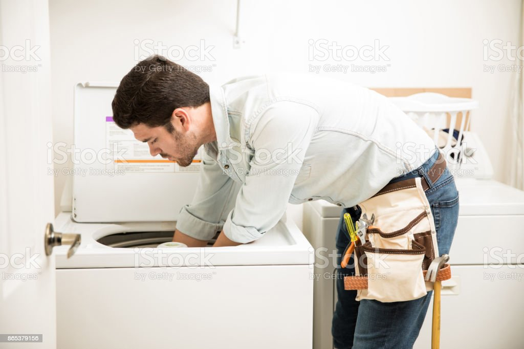 Technician repairing a washer stock photo