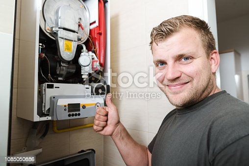 503952312istockphoto Technician repairing Gas Furnace 1085050886