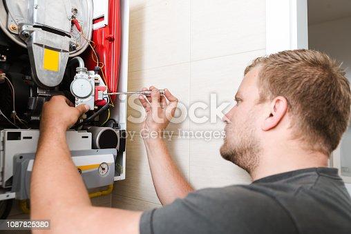 503952312istockphoto Technician repairing Gas Furnace 1087825380