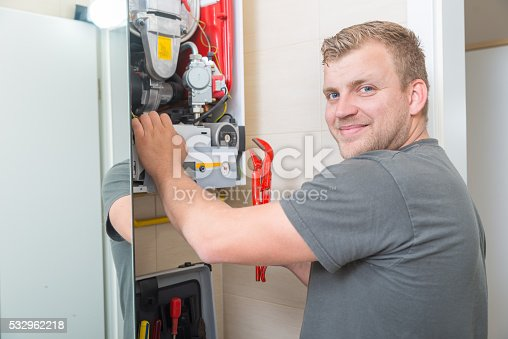 istock Technician repairing Gas Furnace 532962218