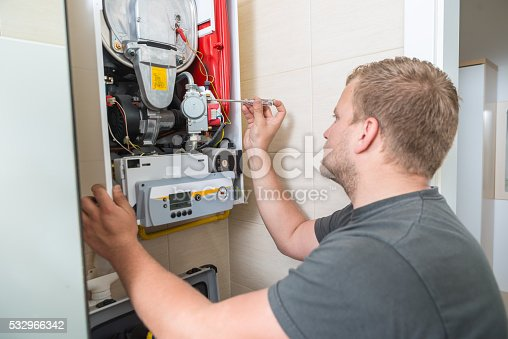 istock Technician repairing Gas Furnace 532966342