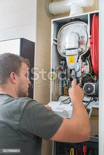 istock Technician repairing Gas Furnace 532966654