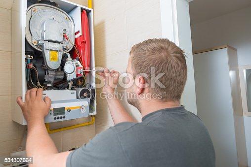 181530805istockphoto Technician repairing Gas Furnace 534307664