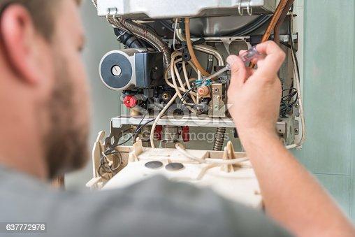 181530805istockphoto Technician repairing Gas Furnace 637772976