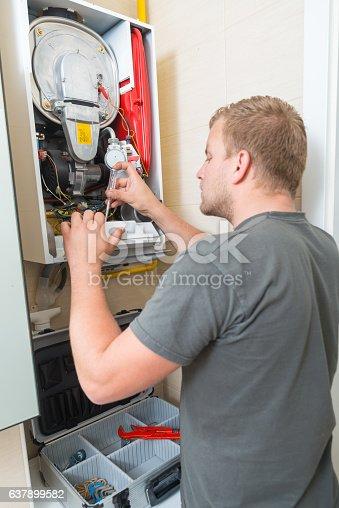 istock Technician repairing Gas Furnace 637899582