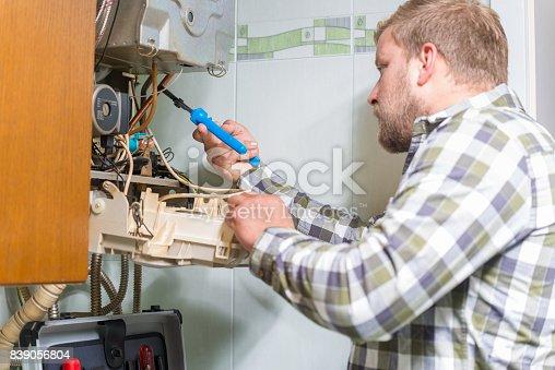 503952312istockphoto Technician repairing Gas Furnace 839056804