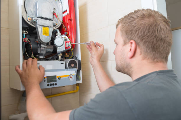technician repairing gas furnace - furnace stock photos and pictures