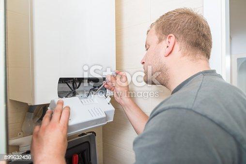 503952312istockphoto Technician repairing Gas Furnace 899632436
