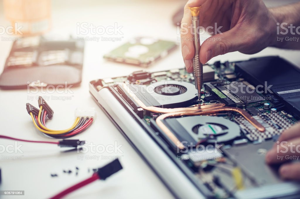 technician repairing laptop computer closeup stock photo
