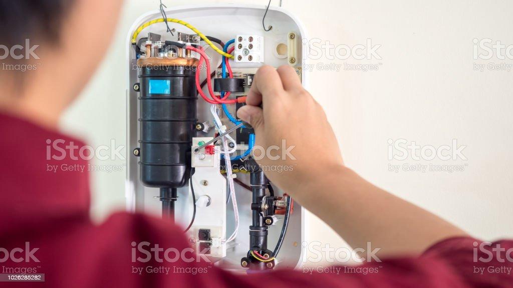Technician repairing water heater