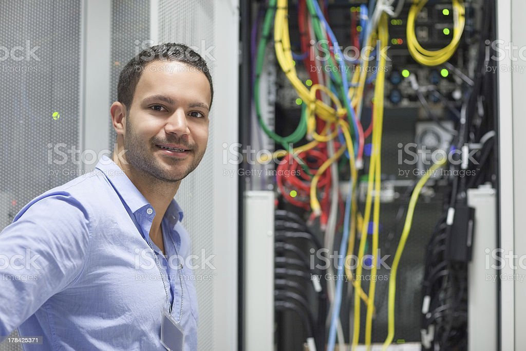 Technician sanding next to the data sore stock photo