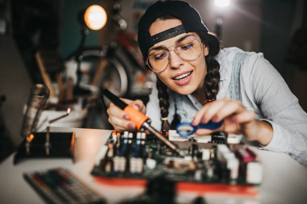 IT technician soldering circuit board IT technician soldering circuit board soldering iron stock pictures, royalty-free photos & images