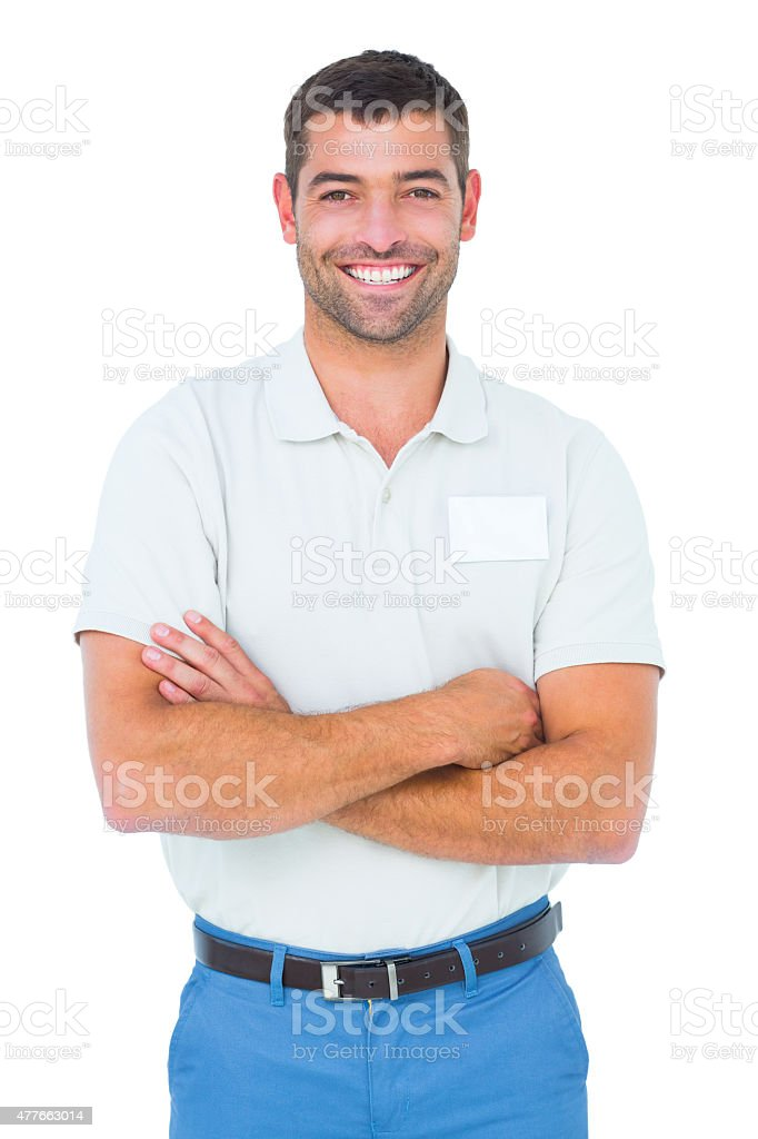 Technician standing arms crossed on white background stock photo