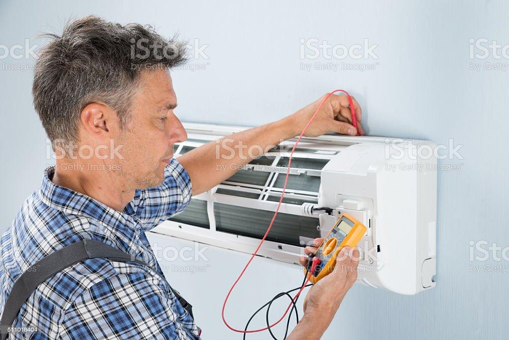 Technician Testing Air Conditioner stock photo