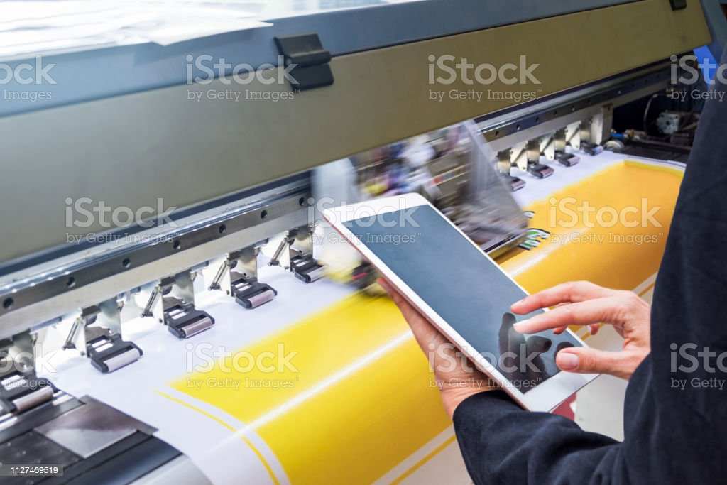 Technician Touch Control Tablet On Format Inkjet Printer During