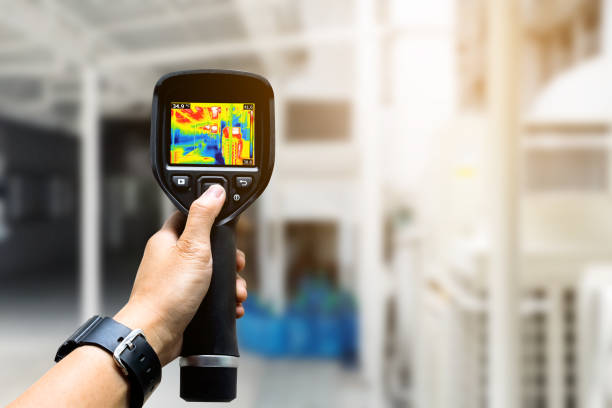 Technician use thermal imaging camera to check temperature in factory Technician use thermal imaging camera to check temperature in factory sensor stock pictures, royalty-free photos & images