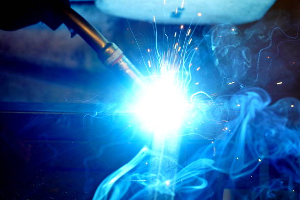 technician welding steel heavy pipes stock photo