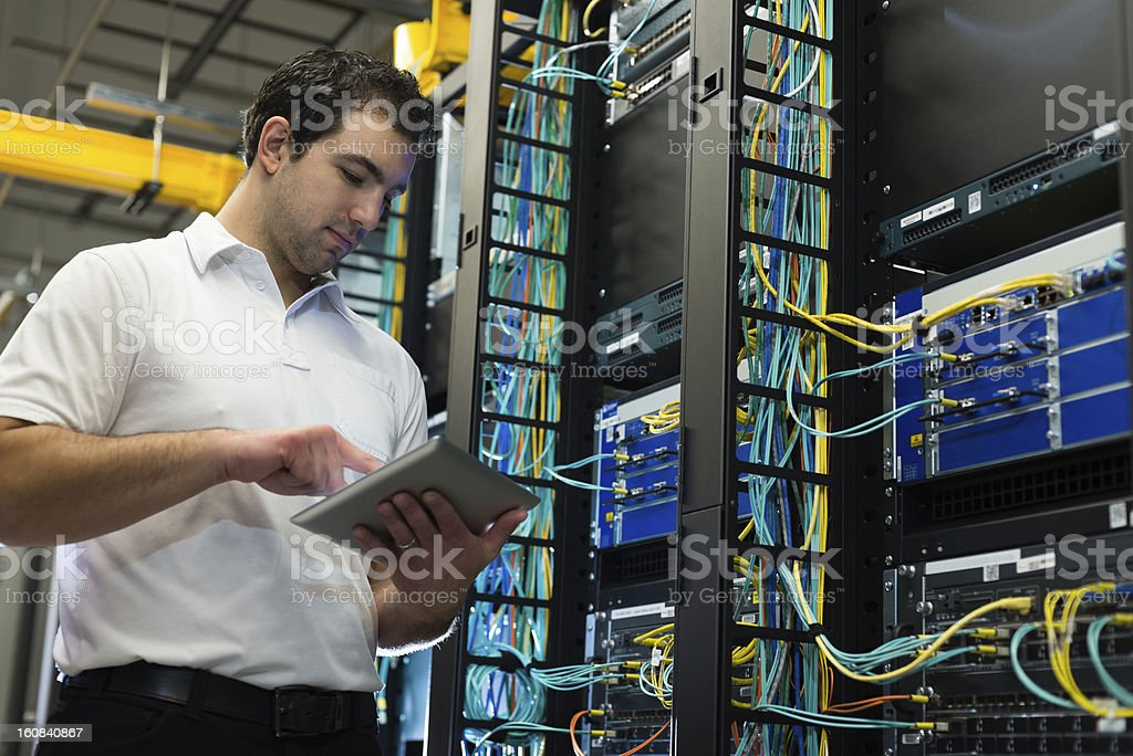IT technician with network equipment and cables stock photo