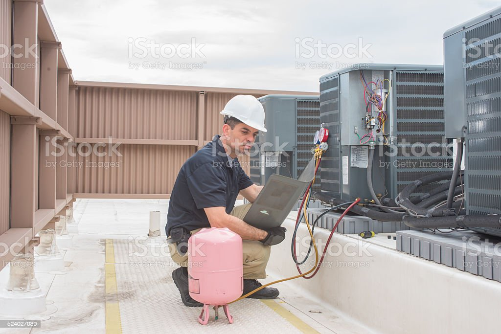 HVAC Technician with panel stock photo
