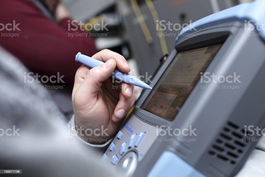 Technician with telecom analyzer stock photo