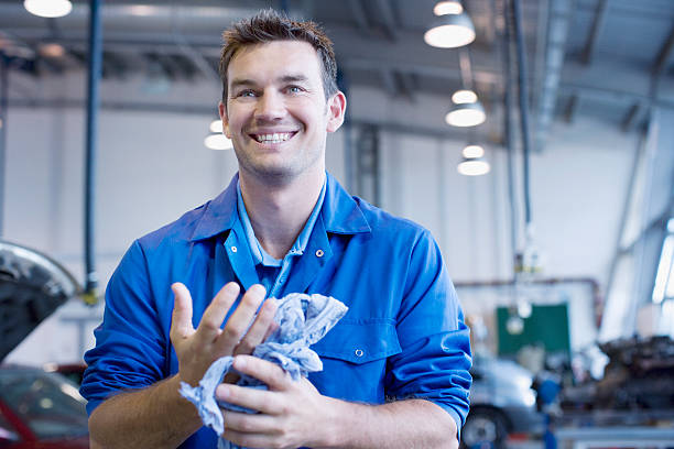 Technician working in auto shop stock photo