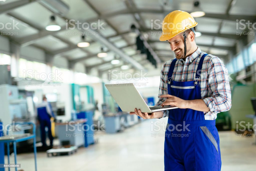 Technician working in factory and doing quality control stock photo