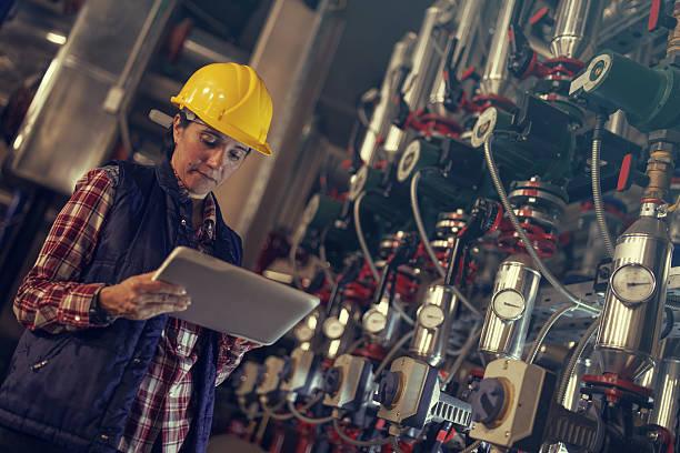 technician working in factory or utility - kvinna ventilationssystem bildbanksfoton och bilder