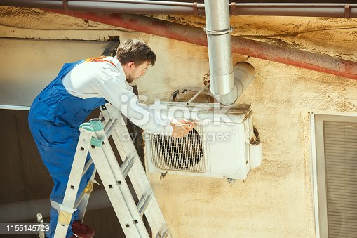 istock HVAC technician working on a capacitor part for condensing unit 1155145729