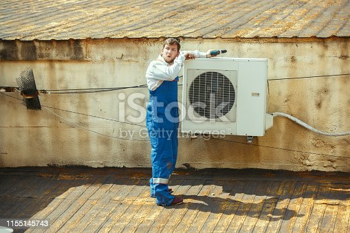 istock HVAC technician working on a capacitor part for condensing unit 1155145743