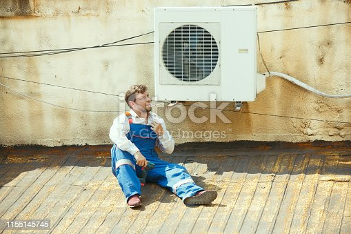 istock HVAC technician working on a capacitor part for condensing unit 1155145745