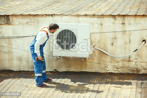 istock HVAC technician working on a capacitor part for condensing unit 1155145751