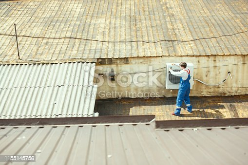 istock HVAC technician working on a capacitor part for condensing unit 1155145756