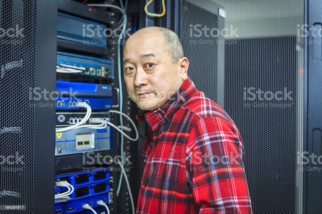 Technician working on a server royalty-free stock photo