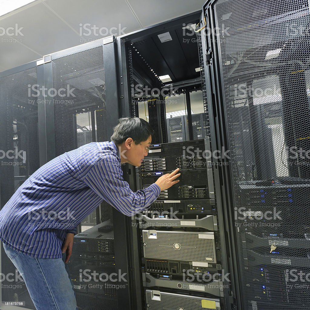 IT Technician working with keyboard royalty-free stock photo