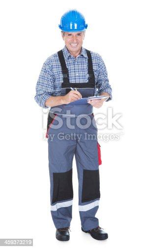 istock Technician Writing On Clipboard 459373219