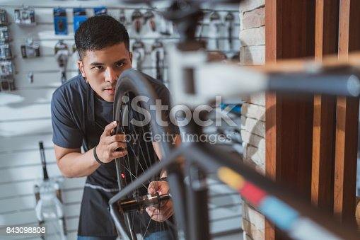 952953976istockphoto Technicians are repairing bicycles at shop sells 843098808