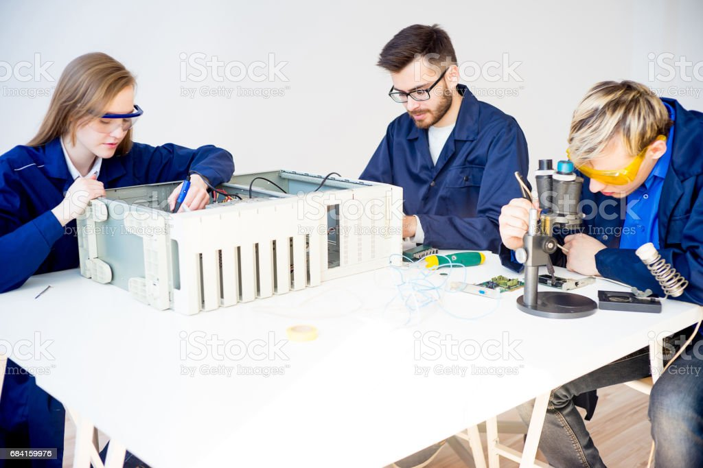 Technicians repairing computers royalty-free stock photo