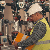 Technicians working in factory or utility