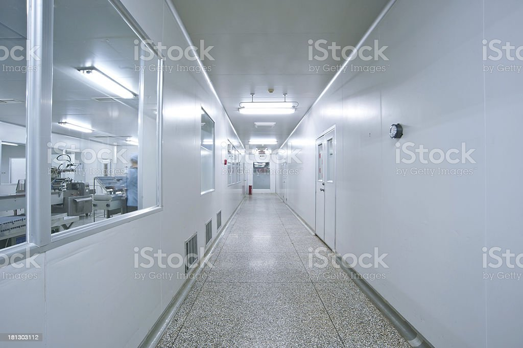 Technicians working in the pharmaceutical production line stock photo