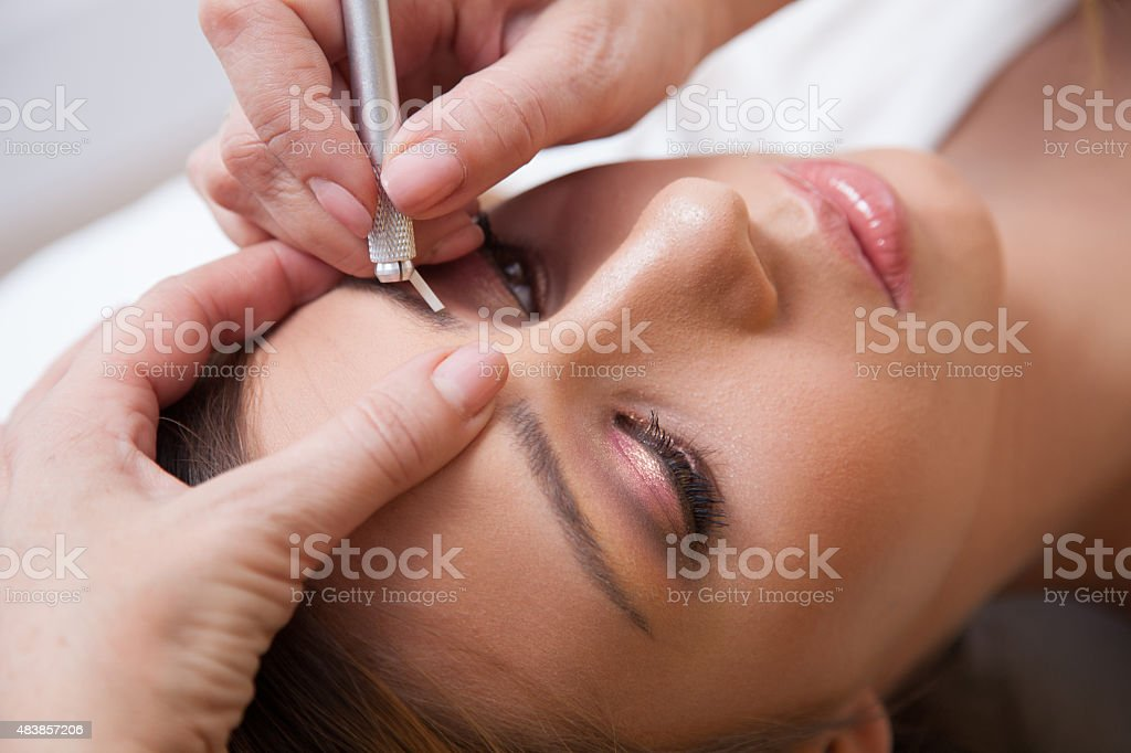 Technique of drawing eyebrows stock photo