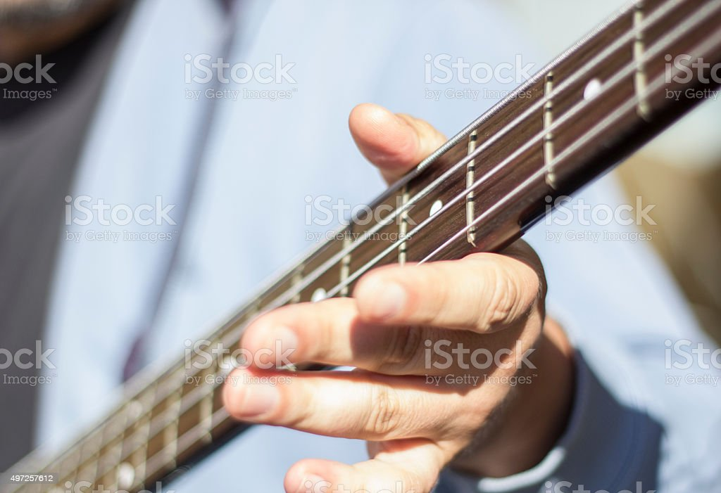 Techniques of playing bass guitar. Bass slapping. stock photo