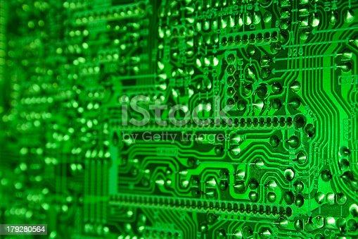 Green computer circuit details in neon light