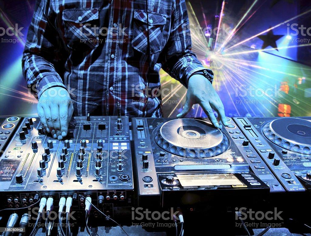 Techno DJ working nightclub party stock photo